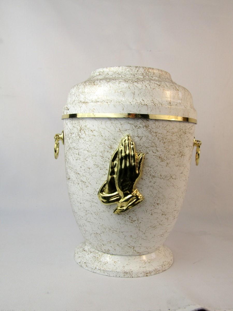 Biała urna z dłońmi