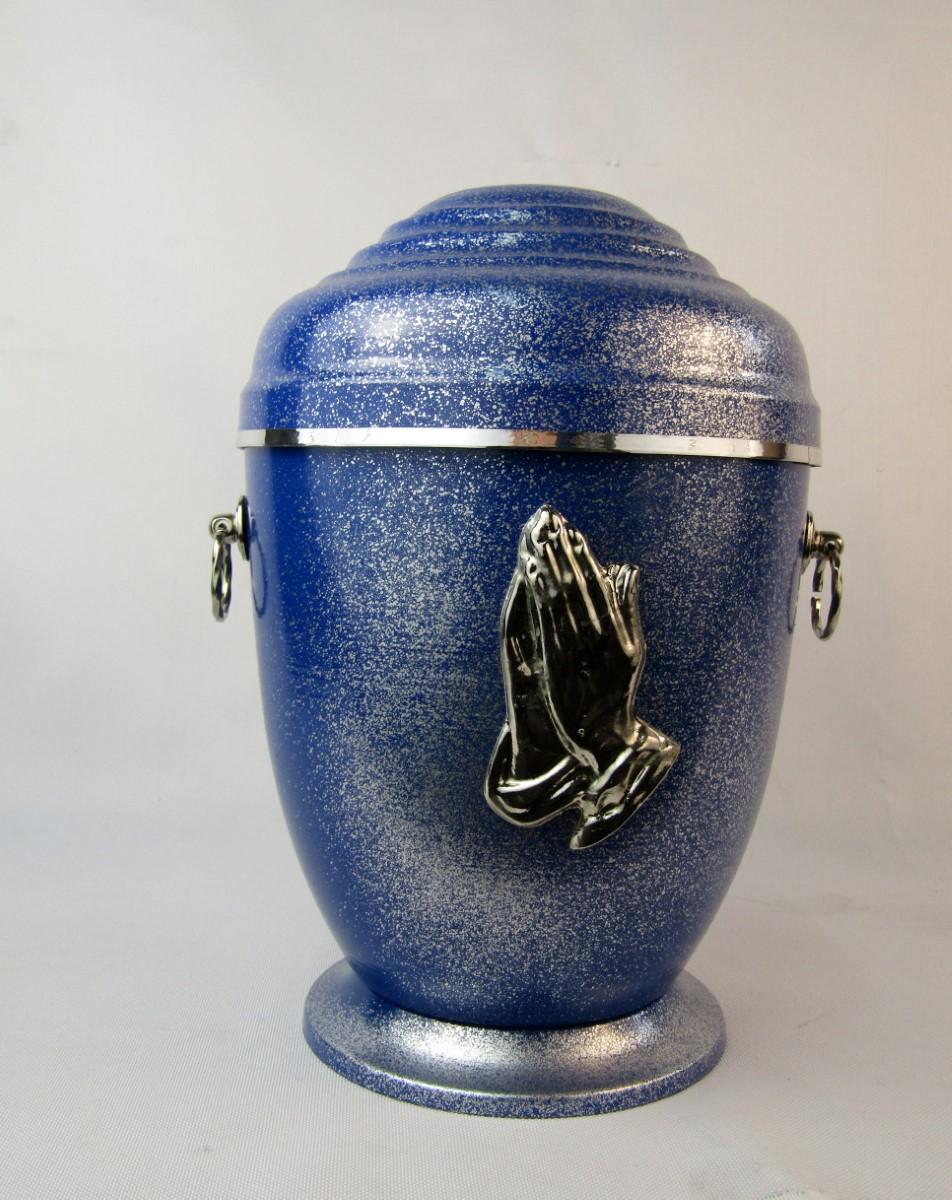 Urna z dłońmi