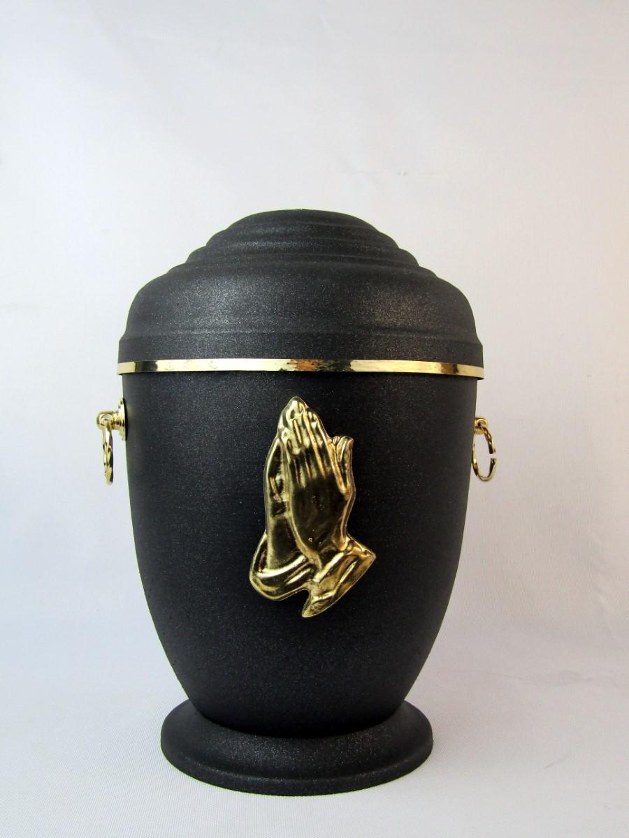 czarna urna z dłońmi