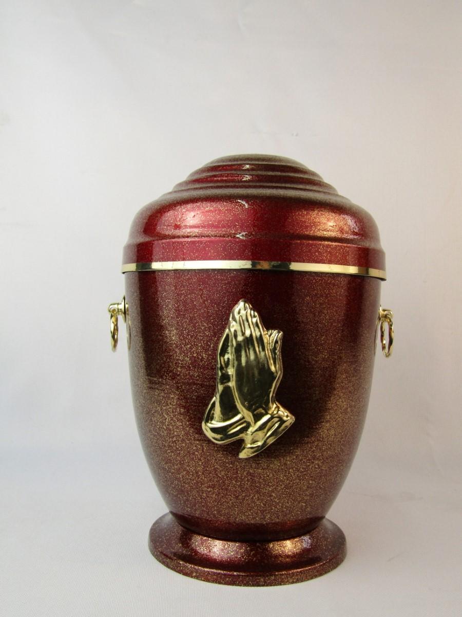 Czerwona urna z dłońmi